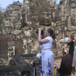 Top of the Bayon Tourist.The russian young lady I met taking the Photos of Bayon Temple.