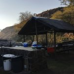 Camping area with braai and communal table facing the river