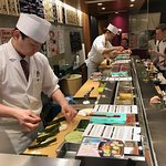Sushi rolls prepared in seconds in front of your eyes.