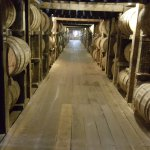Looking down a row of bourbon barrels at Heaven Hill warehouse.