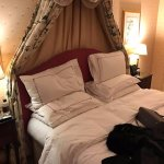 Executive Deluxe Room bed with lavender bed spray and water for turn down every night.