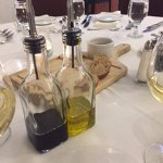 Oil and vinegar and breads for dipping