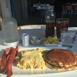 ice tea, bacon, made to order scrambled eggs, true butter milk pancakes w /real /maple syrup