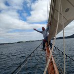 On the bowsprit.