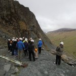 At the mine exit, high on the crag side above the Honister Pass