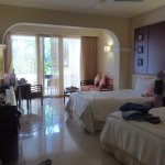 our deluxe room. 2 double beds, sofa and table plus 2 chairs and table. nice large bathroom.