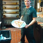 "12"" slice of brick oven pizza"