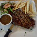 Scotch fillet with chip and salad, and pepper sauce