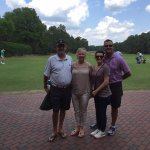 The lucky travelers standing at the #1 tee at Pinehurst #2