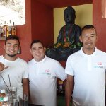 The staff at the bar, with Bhudda watching. Great guys — they know their mixocology.