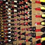 A few bottles in the wine cellar.