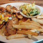 Blackened Tilapia with Shrimp, Mango salsa and sides of French fries and Broccoli rice casserole