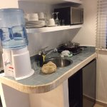 Very well stocked kitchenette with blender and coffee maker up top