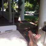 The front porch is a perfect place to relax, read or steal an afternoon nap!