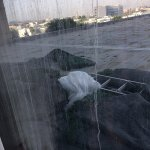 Not the nicest view. Dirty windows behind net curtains and building materials seen on the 2nd fl