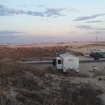 The campground is situated among the dunes and provides easy access and a front row seat for sun