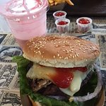 Mushroom Swiss burger with frings and strawberry milkshake.