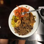 Rice and beans, beef stew, plantains and carrot salad