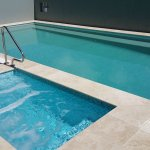 New, wet edge lap pool with in ground heated spa.