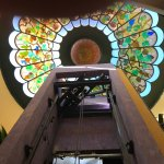 Stained glass above glass elevator