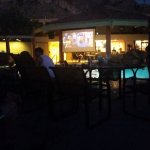 movie playing in pool area