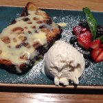 Dark Chocolate Croissant Bread Pudding with ice cream and fresh berries