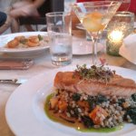 Salmon dish with Negroni drink