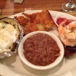 Sirloin steak, prawns, house beans, their great garlic toast and a fresh baked potato.