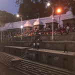 Evening festivities at the river near Crematoria, Kathmandu, Nepal