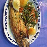 Yum yum yum!  I had the roasted sea bass and it was delicious!  My friends had Fideua which was