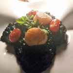 Squid ink risotto with seared scallops