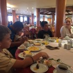 Breakfast on board the nile cruise, note our tour guide playing with our youngest daughter.