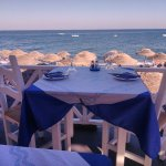 Enjoy your lunch or dinner next to the famous Black Beach of Kamari