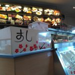 Cabinet with sushi and menu board