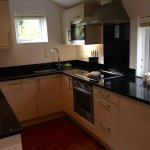 Kitchen with fridge, freezer, dishwasher, oven, hob, microwave and washing machine