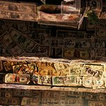 Put your name on a dollar and paste it to the ceiling. I put my spare dollars in the tip jar.