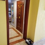 Door wide open - housekeeper in the bathroom - security violation