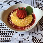 Pineapple on Raspberry Coulis with Toasted Coconut