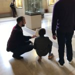 Captivated kids and adults at the Louvre