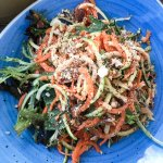 great salad over a bed of shredded lamb