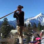 Alphorn player on balcony outside dining room
