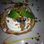 layered pancakes with chia seeds, granola, Greek yoghurt, mint leaves and blueberries