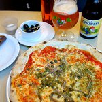 Pizza with appetizers and ale