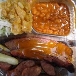 In a 'to go' container; we ate outside. Slaw, potato salad, beans, brisket, sausage, pickles, on