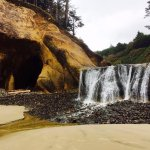 waterfall and cave to the north (around promontory). wait for low tide to access!