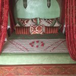 Four poster bed with rose petals on arrival.
