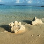 The only two rocks on the beach, the sand is pure white, gentle, floury softness.