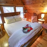 The Sugar Pine suite features a two person corner jetted tub, fireplace, and total romance.