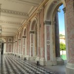 Pink marble columns along the hallway at the Grand Trianon.