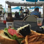 Cheeseburger, cool beer, overlooking live music under the warm April sun!